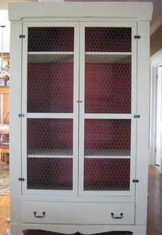 I repurposed this antique wardrobe with shelves and painted it a soft country green with a brick red back panel, added chicken wire to the doors and I think it transformed wonderfully:)