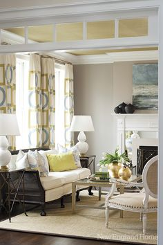 Designer Jan Hiltz played up the living room's brightness with a ceiling covered in gold grasscloth, gold accessories and a geometric print Victoria Hagen fabric for the draperies that has its own golden glow.