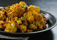 Indian-Style Cauliflower - low carb - metabolism booster! Tossed in spices and roasted at a high heat, cauliflower is transformed into a nutty, crispy, flavorful side dish, perfect alongside a simple roast chicken or hearty stew.