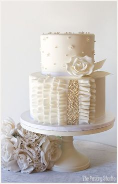 Petite all White Wedding Cake with Ruffle and Pearls / http://www.deerpearlflowers.com/32-wedding-cakes-with-classical-details/