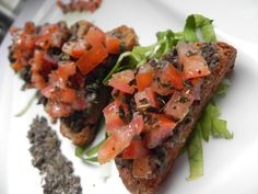 Brochette with olive tapenade and tomato segments (toasted bread olive, caper, anchovies, lemon juice, tomato, basil, olive oil)