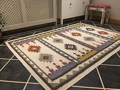 Gorgeous design kilim rug with rich geometric design; From a Fair Trade source in India and hand woven on a flat loom. This kilim is finely woven so the rug is no thicker than 1cm. Photographs are representative and the item you receive may vary slightly.