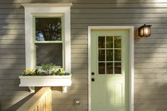 Sherwin Williams Anonymous SW 7046 - a brownish gray. Door and window sash are Sherwin Williams Recycled Glass SW 7747 - a light/bright green.
