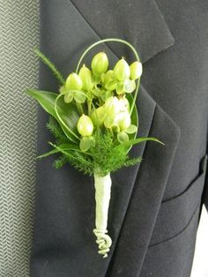 Boutonnieres don't have to be a rose or traditional flower...here we used green hypericum berries, grass and mixed foliage to create a masculine look.