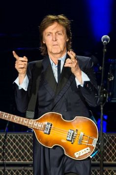 """Sir Paul McCartney performs for nearly 45,000 screaming fans during the Seattle leg of his """"Out There"""" tour."""