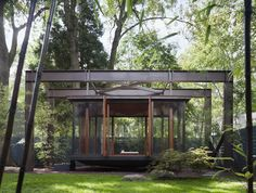Built by David Jameson Architect in Bethesda, United States with date 2009. Images by Paul Warchol Photography. The Tea House is nestled within a leafy backyard of a suburban home. Constructed of bronze and glass, the new structu...