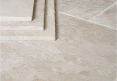 Dense Creamy Marble Tiles With Distinctive Veining And Quartz Detail Whilst The Background Colour Is Predominately Cream This Also Contains Beige