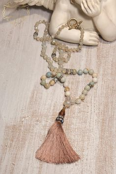 Silk Tassel Necklace, Boho Chic Necklace, Bohemian Necklace, Statement Necklace, Christmas Gift, Amazonite. A Unique , beautiful, hand knotted long Tassel Necklace . Features antique rhinestones, ivory - beige opalescent crystal beads , Amazonite and aquamarine gemstones, soft