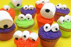 Mini Halloween Monster Cupcakes! LOL how cute and simple! Marshmallow eyes!