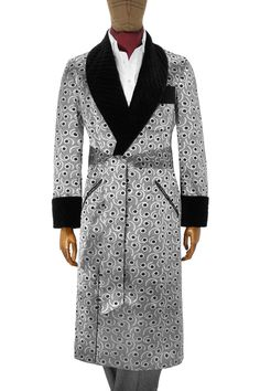 <p><p>The exquisite silk in this dressing gown is woven in Italy in a design inspired by the 'eyes' found in art deco drawings of peacock feathers. The gown is reminiscent of the wardrobe worn by leading men of the golden era of Hollywood. With jetted pockets and a quilted black velvet collar and matching gauntlet cuffs, it is punctuated with black corded piping throughout.<p><p>Our dressing gowns are available in limited numbers and can be amended for sleeve and body length measurements…