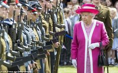 The Queen wore an eye catching fuschia pink ensemble during a visit to the Berkhamsted School in Hertforshire this morning