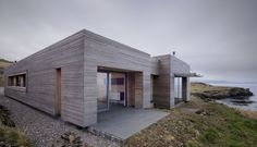 The Tigh Port na Long house on the Isle of Skye in Scotland - A project completed by Dualchas Architects. The team of Dualchas Architects has completed Architecture Durable, Architecture Résidentielle, Larch Cladding, Roof Cladding, Stone Cladding, Architects Journal, Long House, Design Exterior, Minimalist Home