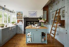 Located inside a Victorian watermill built in 1862, this English kitchen is chock-full of charm! When the homeowners wanted to renovate their incredible property, they turned to Churchwood Design to c