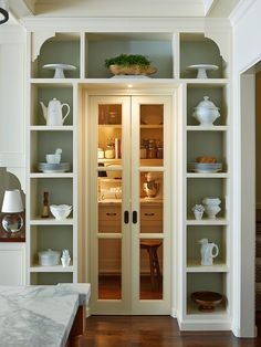 Kitchen pantry, compressed french doors, shelving archway | Lorin Hill, Architect