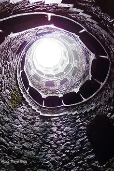 On the bottom of Initiation Well in the garden of Quinta da Regaleira. Sintra, Portugal.