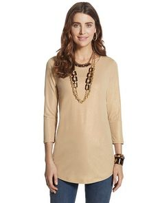 The long knit top shimmers with allover metallic sparkle and is comfy-chic in a flattering length.