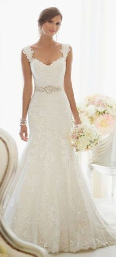 Beautiful lace wedding dress with jewel band.