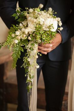 soft modern cascade bouquet, rustic antique Photo by Laura Luís, Three Lights Photography