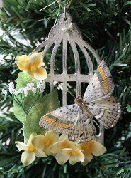 Follow this Vintage Bird Cage Ornament tutorial to create a truly incredible tree decoration. Use acrylic paints, a butterfly embellishment and other fun materials for this vintage craft.