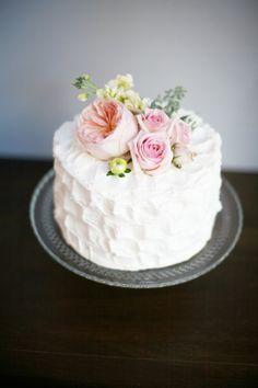 Simple small wedding cake... textured buttercream & fresh garden flowers.  Lovely.