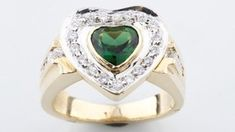 One Electronically tested yellow gold ladies cast green tourmaline and diamond ring. Bright polish finish with rhodium accents. One Bezel Set Heart Mixed Cut Natural Green Tourmaline. Contemporary Engagement Rings, Elegant Engagement Rings, Pink Tourmaline Ring, Heart Shaped Diamond, Valentine Heart, Valentines, Vintage Diamond, Diamond Cuts, Fine Jewelry