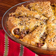 Italian Crescent Casserole  1 lb ground beef  1 cup Garlic Pasta Sauce  1 can 8oz Crescent dinner rolls  1 1/2 cups shredded Italian cheese blend  1/4 teaspoon dried basil leaves  Cook beef, mix in sauce  Press 1/2 dough in un-greased 9-inch round in spoke pattern.  Sprinkle 1 cup of the cheese.  Spoon meat mixture over cheese.  Fold 1/2 dough over filling to meet in center; do not overlap.  Sprinkle with 1/2 cup cheese over the dish followed by the basil.   Bake at 375°F 15 to 20 min.