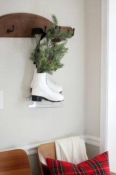 Christmas Colonial Entry Way - Fresh greens in ice skates.  Lovely~