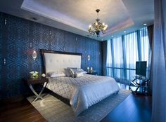 black, white, plum, crystal, glam eclectic bedroom, groovy wallpaper stencil wall treatment, shine, crystals, dark and light, sapphire blue, black, upholstered white headboard, metallic silver chrome metal side table wood, chandelier, recessed lights bedroom