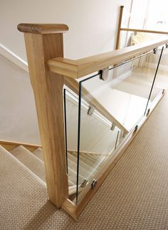 Oak and Glass Staircases - Neville Johnson Staircases This modern oak and glass staircase combine beautiful design with the finest materials and superb craftsmanship for a feature that will last for decades.