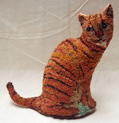 Doorstop Noahs cat hooked by Mary Burton