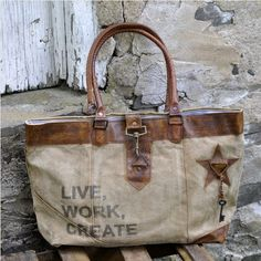 The Working Carry All Tote features khaki colored tarp with leather handles and accents. The extra embellishments like the dangling key, metal buckles, and printed graphics make this bag as unique as it is useful! Canvas Purse, Canvas Tote Bags, Grey Tote Bags, Hipster Bag, Hermes, Creation Couture, Tote Handbags, Grey Handbags, Canvas Handbags