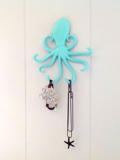The octopus is the perfect hook to hold jewelry! Available here: https://www.etsy.com/listing/187526692/cast-iron-octopus-hook-jewelry-holder Many colors to choose from!