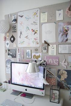 massive pinboard behind desk