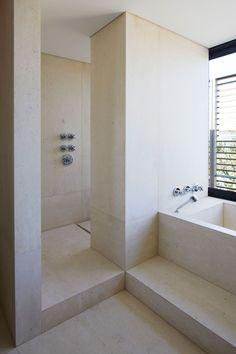 Travertine or limestone shower /monochromatic - seamless with living room floor ?
