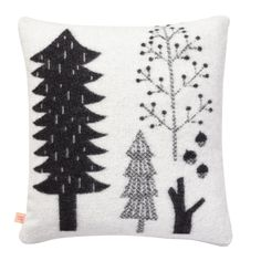 This super soft and cosy cushion is the perfect couch companion on a cold winter's night. Different trees featured on each side. 100% soft lambswool, woven