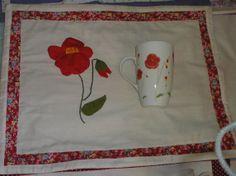 A flor na caneca e no bordado - Olinda Aguiar.
