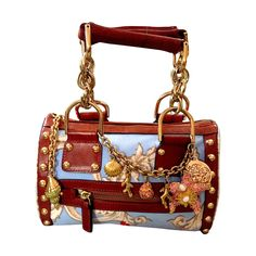 Versace Vintage Sea Shell Mini Handbag 1992 | From a collection of rare vintage top handle bags at https://www.1stdibs.com/fashion/handbags-purses-bags/top-handle-bags/