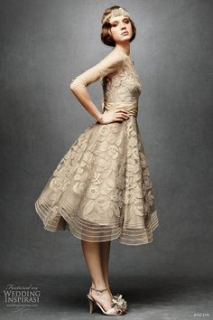 Tracy Reese retro style 3/4 sleeve tulle era dress with floral appliques dotted with Swarovski crystal. Ruched band of silk taffeta at the waist and a voluminous, below-the-knee scalloped skirt.