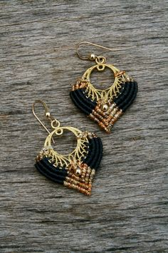egyptian earrings gold tipped black dangle by yasminsjewelry