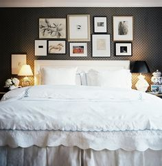 Frames above the bed (also love the effect on the wall, wonder if it's wallpaper, or stencil)