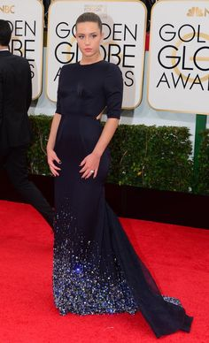 Though the Blue Is the Warmest Color actress is no stranger to the spotlight, the Golden Globe Awards were her first major American red carpet. Exarchopoulos made waves in this daring navy Miu Miu gown with subtle chest details and an open back.Photo by Getty Images