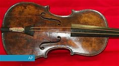 Violin played on sinking Titanic unveiled
