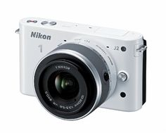 Nikon 1 J2 10.1 MP HD Digital Camera with 10-30mm VR Lens (White) Nikon,http://www.amazon.com/dp/B008V0IJ8G/ref=cm_sw_r_pi_dp_uyaSsb0WBD3APW78