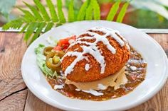 #HulaHut's Kawaikini Stuffed #Avocado! This award-winning dish is a Hula Hut favorite. Made with Hass avocados filled with roasted chicken, green onions, cilantro, Monterey Jack cheese and green chiles, rolled in panko & green chile spices, lightly fried and served on a bed of our homemade Hatch Green Chile & Queso Blanco Sauces. #foodiegems.com