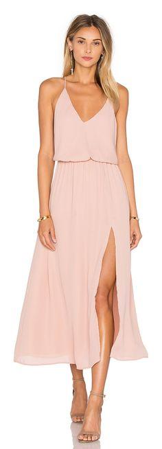X back midi dress by krisa. 100% poly. Fully lined. Adjustable crisscross shoulder straps. Elastic waist. Side slit. Neckline...