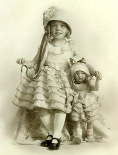 Little girl and her Lenci doll, both dressed by Lenci...