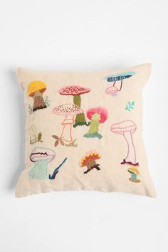 "mushroom pillow (sold out!) UO SKU #20942397.  Update 8/15/12: Actually, just found out that this product was copied directly from Paragon Needlecraft Creative Stitchery ""Mushroom Forest"" Pillow Kit # 0433.  Urban Outfitters, original as always."
