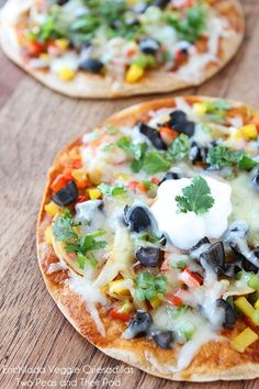 Mexican Pizzas - These crisp quesadillas are covered with enchilada sauce, topped with veggies, and smothered in cheese. Garnish with fresh cilantro, sour cream (or Greek yogurt) and you have a delicious and healthy meal in minutes..