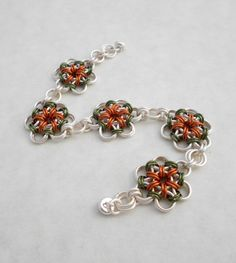 Chainmaille Bracelet, Japanese Flower, Green and Orange, Chainmail. $98.00, via Etsy.