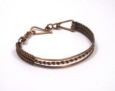 Woven copper wire with a twist.  This bracelet has a hand crafted twisted wire center that accents the design with woven copper.  The design wire for the frame, chain and clasp is hand formed.  Each p